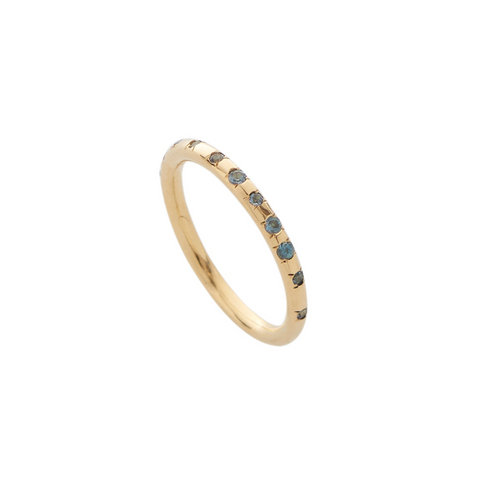A delicate 18ct yellow gold band with 18 flush-set topaz. The perfect compliment to any outfit, or perfect for stacking to create a statement.