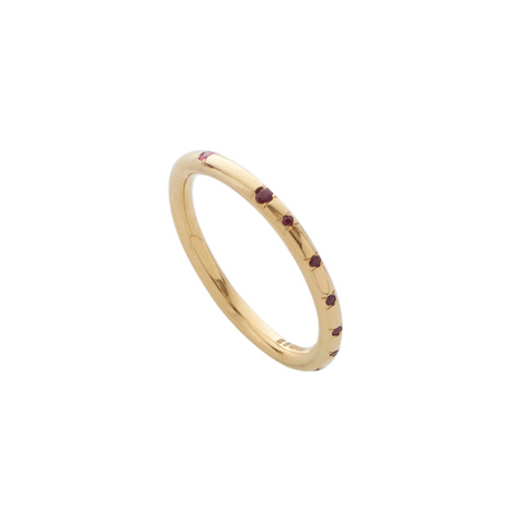 A delicate 18ct yellow gold band that is embellished with 17 flush-set precious rubies. Perfect as an understated ring or for stacking.