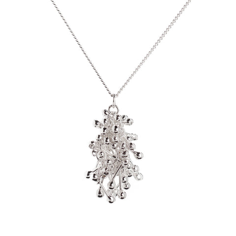 A shimmering cluster of silver elements hangs centrally from a silver chain. Handmade by Yen Jewellery