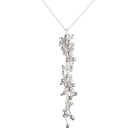 A long thin cluster of silver molecules. Drop cluster hangs from a silver chain. Handmade by Yen Jewellery