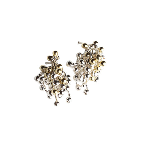 A cluster of gold and silver molecules form these earrings