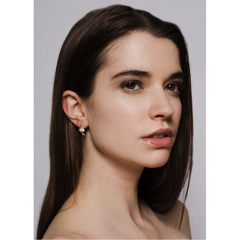Model wears silver and pearl cluster stud earrings. Yen Jewellery