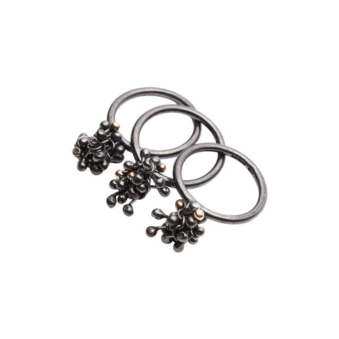 Oxidised silver cluster rings. Small clusters of silver balls connected to the top of the shank. Handmade by Yen Jewellery