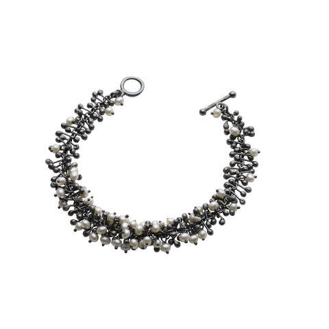 Oxidised silver beads and freshwater pearls. Every component is handmade by Yen Jewellery in her studio