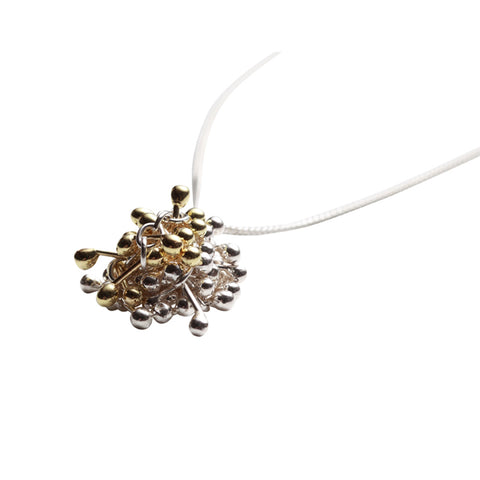 Gold and silver cluster of connected elements. The cluster hangs centrally form a silver chain. Handmade by Yen Jewellery