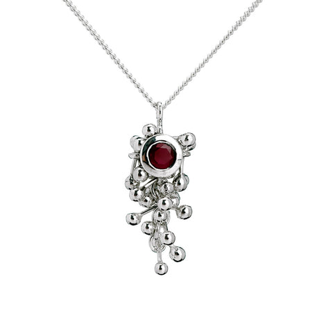 Yen Jewellery A contemporary handmade ruby and silver necklace. Hangs off a chain.
