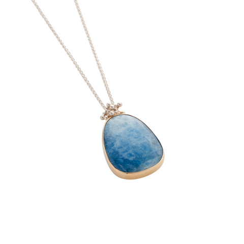 A large and unusual aquamarine gemstone is at the centre of this silver necklace. Handmade by Yen Jewellery, London
