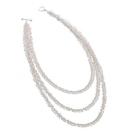 Three strands of silver molecules create this contemporary necklace. This necklace feels soft and follows the contour of the body. Each intricate element is handmade and constructed by Yen Jewellery, London.