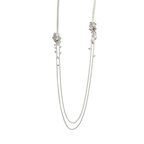Two asymmetric clusters of silver pebbles connected by silver chain. Handmade by Yen Jewellery.