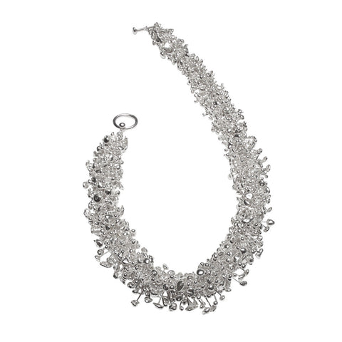 A luxuriously dense strand of silver molecules form this striking choker. Handmade by Yen Jewellery.
