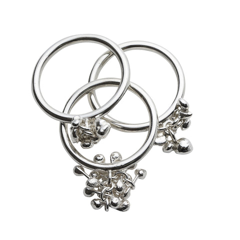 Image of three silver pebble rings, thin round profile shanks with pebble clusters of various sizes. Handmade by Yen Jewellery