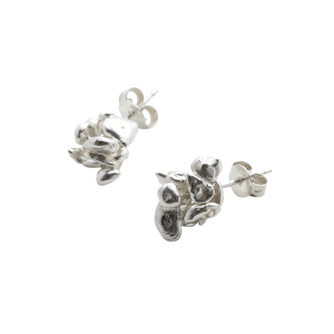 Silver stud earrings handmade by Yen Jewellery. A small cluster of silver pebbles.