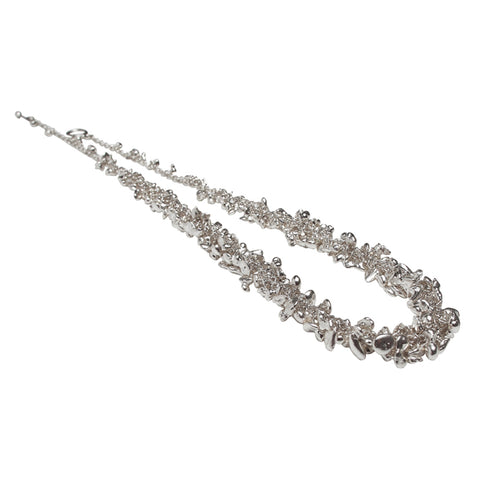 A dense and continuous string of silver pebbles form this choker. Handmade by Yen Jewellery.