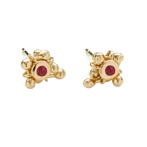 Each stud has a rich ruby set within a cluster of moving 18ct gold elements. Movement is a defining aspect to Yen Jewellery.