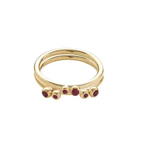 Small rubies set on slim 18ct gold shanks. This image demonstrates how well they stack. A versatile design that is available in a variety of gemstones.