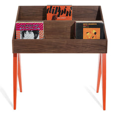 Atocha Design Walnut base with solid American maple legs painted orangey-red.