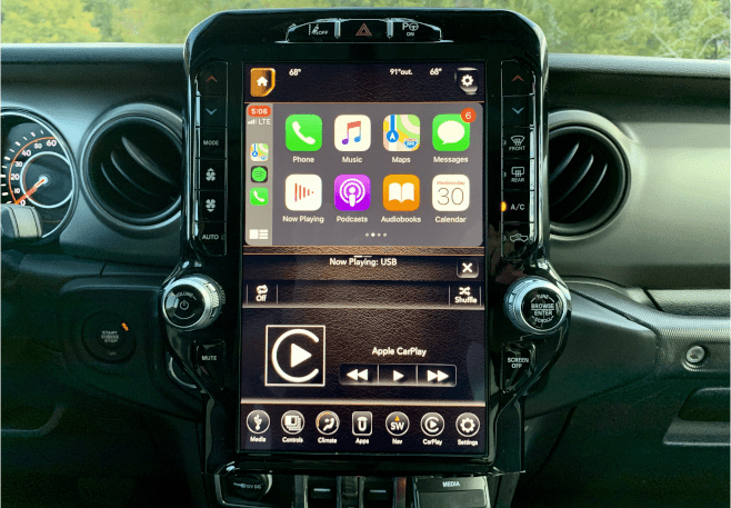 Infotainment.com 2018 Jeep Wrangler JL with Ram 12-inch touchscreen upfit with Apple CarPlay.