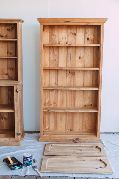 """I can't believe we are finally here - the big reveal! If you haven't already, make sure you check out this quick Instagram Reel I made to share the process of up cycling this bookshelf and hutch. This DIY project has been over three (lonnggg) months in the waiting. You may remember back in February I bought an old timber bookshelf and hutch off Facebook Marketplace for a steal. $250 total to be exact. I had been looking for a unique piece of furniture to store all my treasured secondhand and thrifted ceramics, kitchenware and glassware for a while and Jason suggested I try Facebook Marketplace. I hadn't been searching for long when I found these gorgeous pieces and they came as a package deal, both which came from a loving home and were custom built for the owners back in 1996. The owners were moving into a smaller home in Buderim and no longer needed them, which was great news for me!  Since then, you have been on a journey of epic proportions with me over on Instagram helping me make all the decisions with this upcycle project and I honestly could not have transformed both pieces without your valuable guidance. When they arrived I wasn't sure if I should paint them or not, mostly because I loved the warm colour of the stained timber and truthfully, I have never been a fan of painting furniture. It just always looked so flat to me. I threw my conundrum out to you guys on Instagram and you voted I should paint it. And that was that. If I was going to upcycle these pieces, I knew I had go all in or nothing. Read on to see how I upcycled these beautiful pieces.     BEFORE                                                                                    AFTER  Before-and-After-DIY-Upcycled-Bookshelf-and-Hutch      Materials   Old cloth Sanding block/sponge from Bunnings  Resene """"Sourdough"""" in semi-gloss (water based) Water based white primer Cutting in brush Microfibre rolling brush Paint tray  Drop sheet """"Pika"""" cabinetry knobs from ABI Interiors  Rebate power tool  G"""