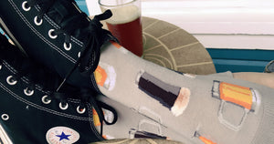 Beer socks with a pattern of craft beer varieties in mugs and glasses.