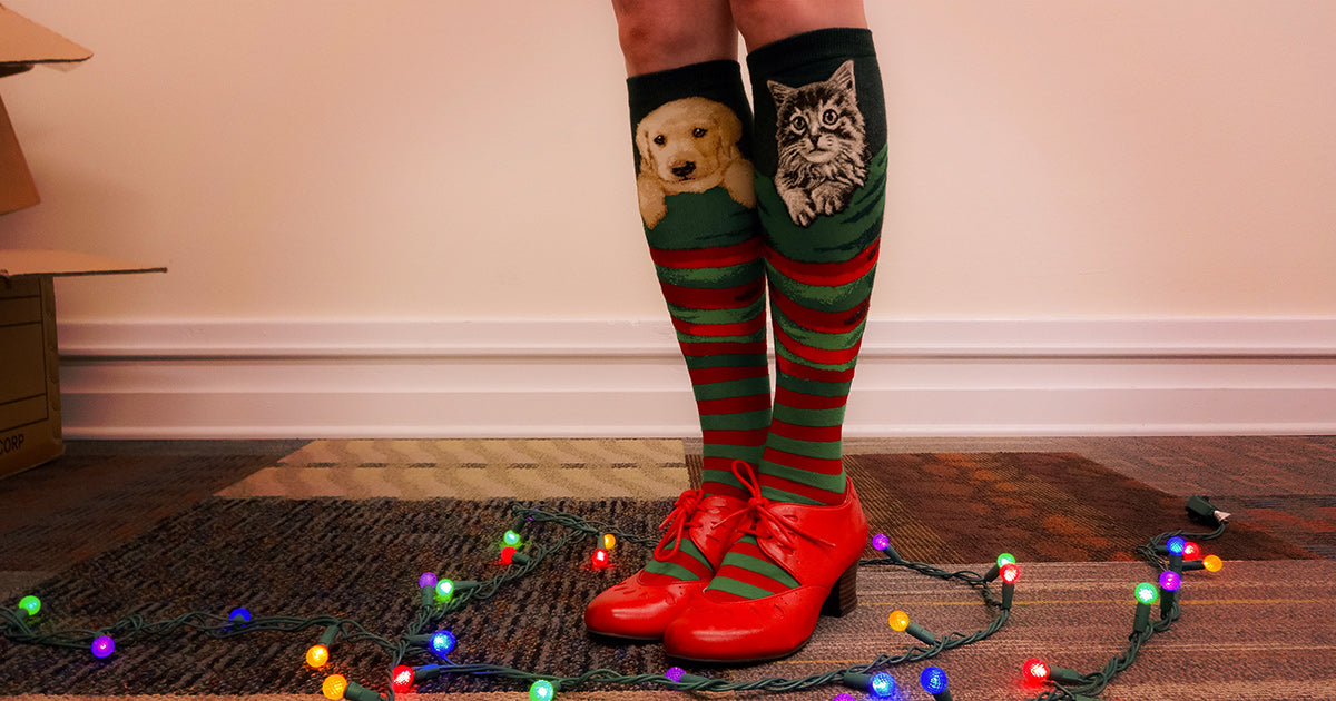 Knee-high Christmas socks that look like stockings with a puppy and a kitten inside.