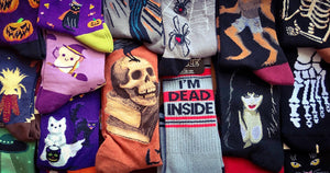 Halloween socks including jack-o-lanterns, witches, cats, ghosts and skeletons.