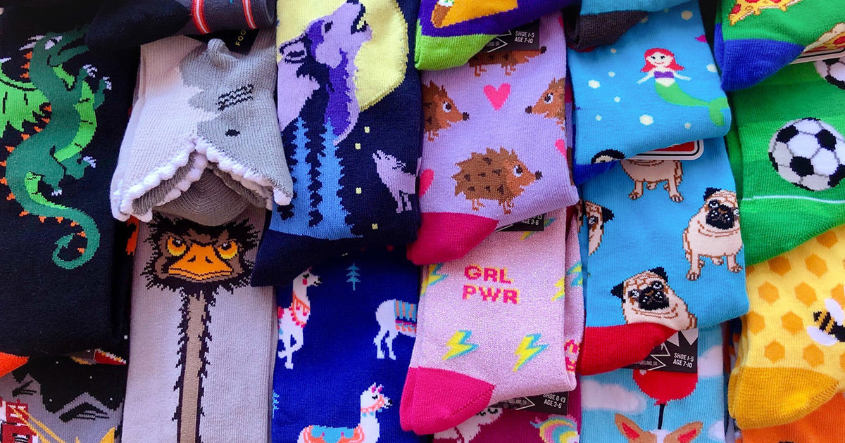 Fun, novelty kids' socks with animals, sports and girl-power designs.