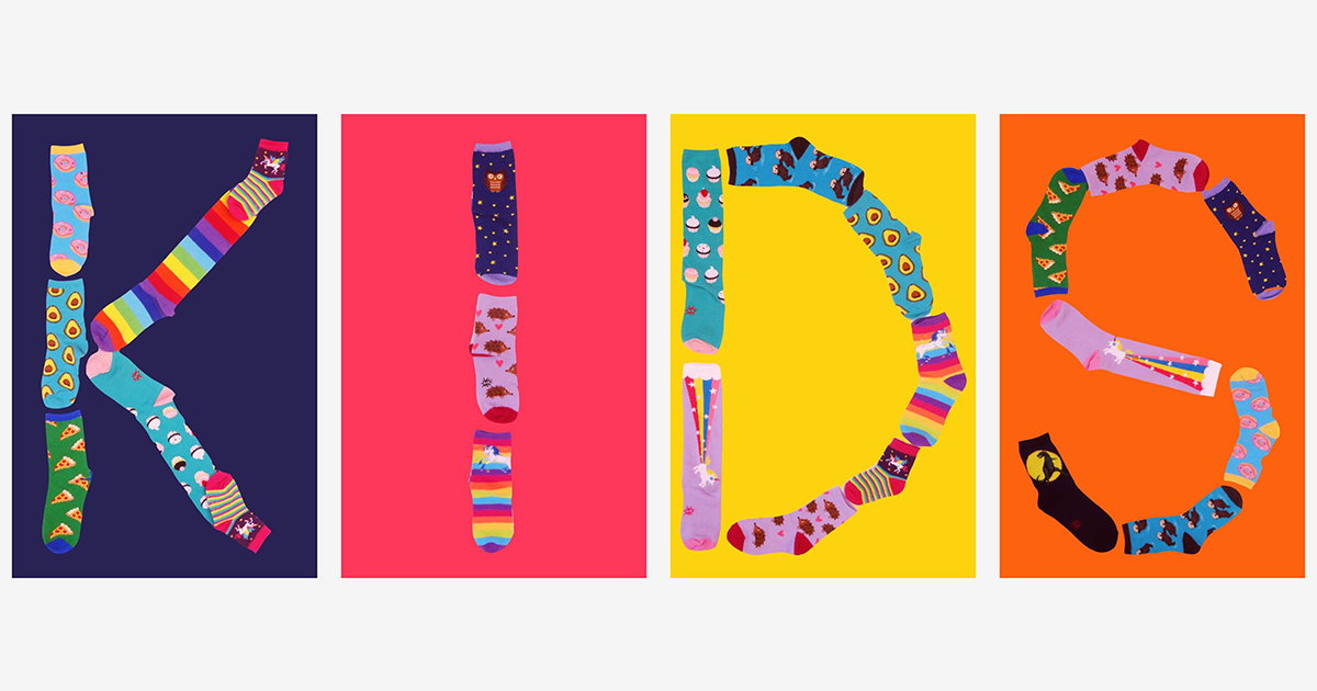 "Fun back-to-school socks for kids spell out the word ""KIDS."""