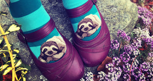 Cute sloth socks peep over the toes of magenta shoes