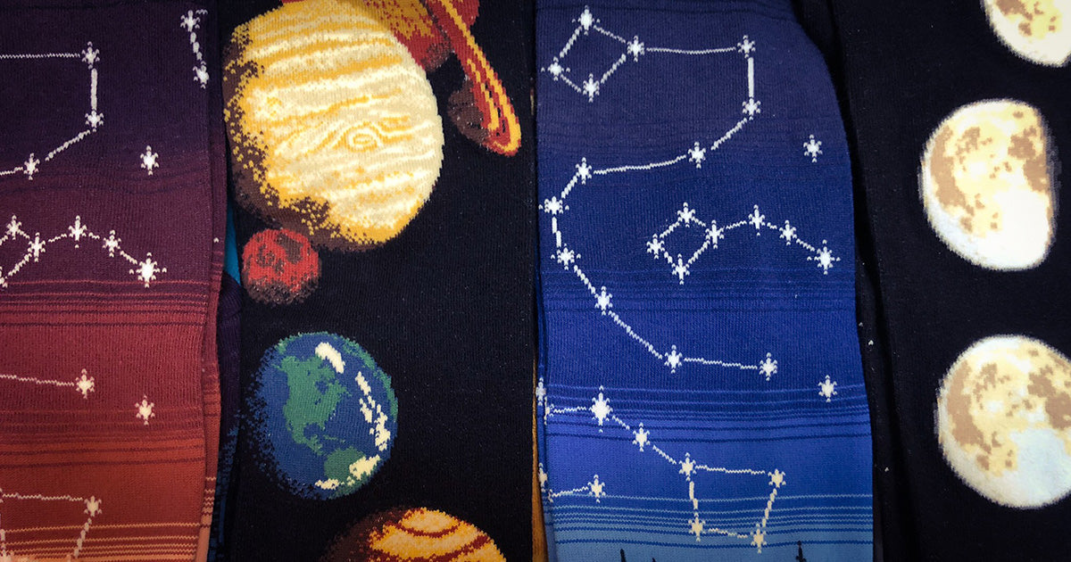 Space socks with constellations, planets and moon phases.