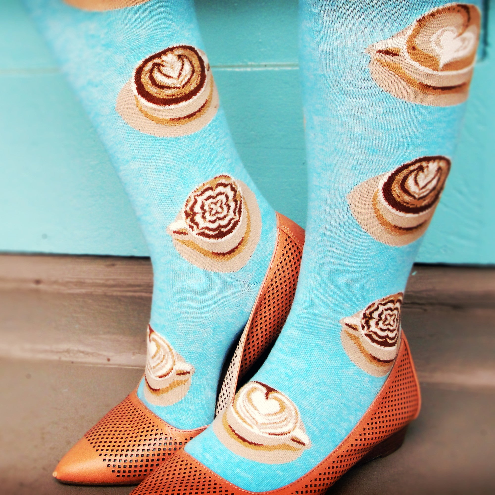Coffee socks, like ModSocks' cute aqua knee socks featuring cups of latte art, are the best part of waking up.