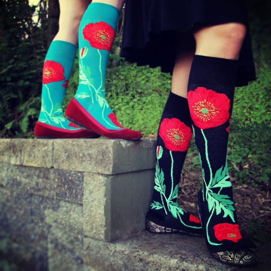 Red poppy flowers grow up these floral knee-high socks by ModSocks.