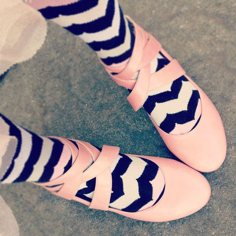 Pink ballerina shoes with curved chevron pink and black socks