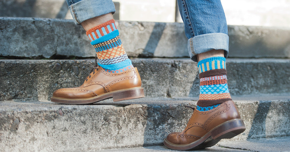 Extra large men's socks with colorful patterns.