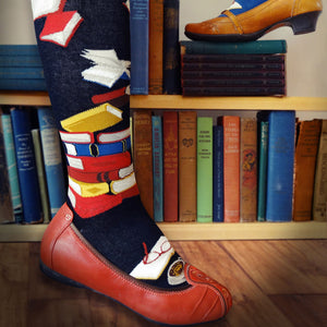 Book socks with red, yellow and blue books on a black sock.
