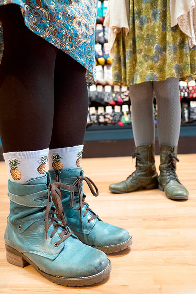 Boots worn with socks and skirt outfits
