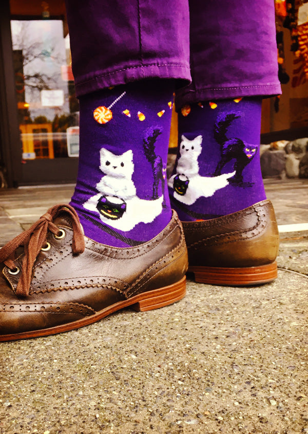 Funny Halloween cat socks with cats trick-or-treating dressed as ghosts