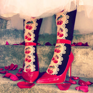 Knee high cherry socks with lace and red ribbon bows.