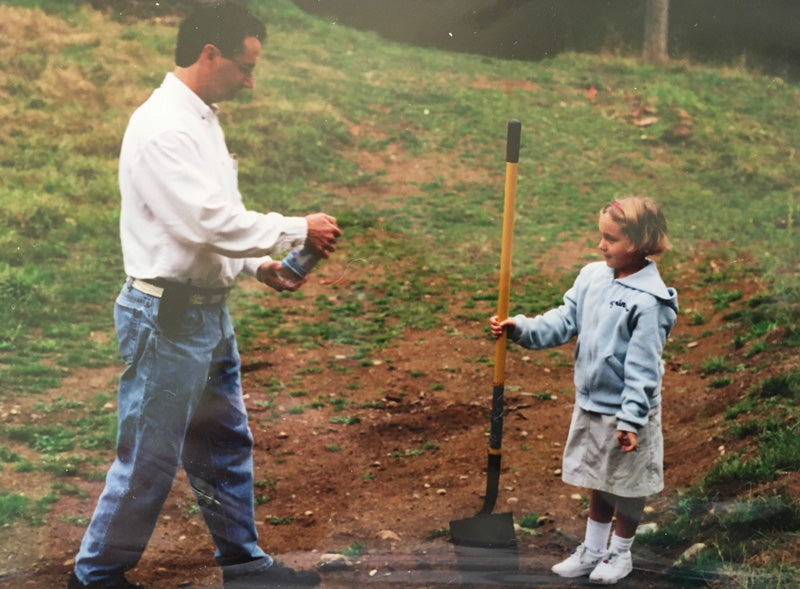 Father daughter digging hole