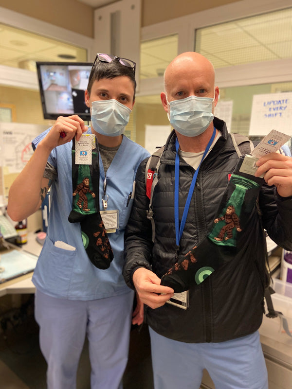 Harborview medical staff shows their Sasquatch UFO socks.