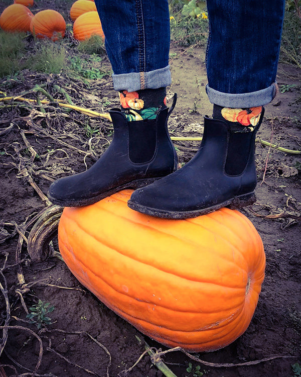 Funny squash socks look great with the pumpkin this person is standing on