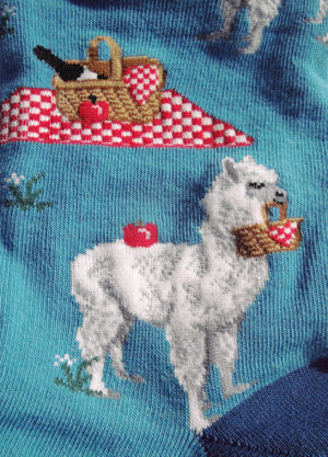 Cute alpaca picnic socks show details of alpacas holding baskets