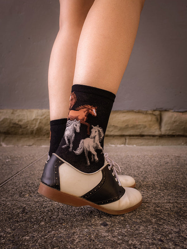 Cute horse socks with saddle shoes standing on a sidewalk