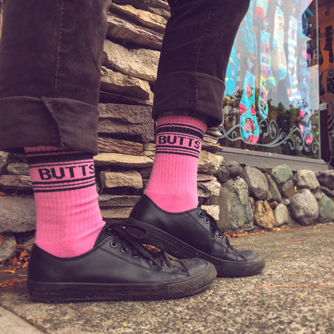 "Funny butt socks that say ""BUTTS"" on a pink background"