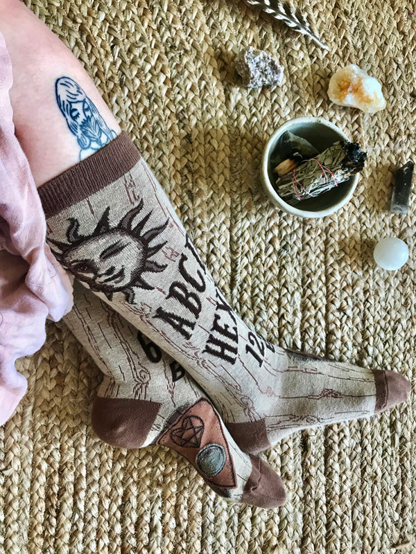 "Funny ouija board socks that say ""Hexes for Exes"""