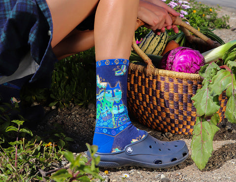Cat socks for women by Laurel Burch in the garden