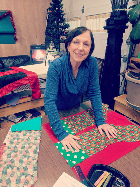 A volunteer sews stockings for Bellingham's Stocking Project