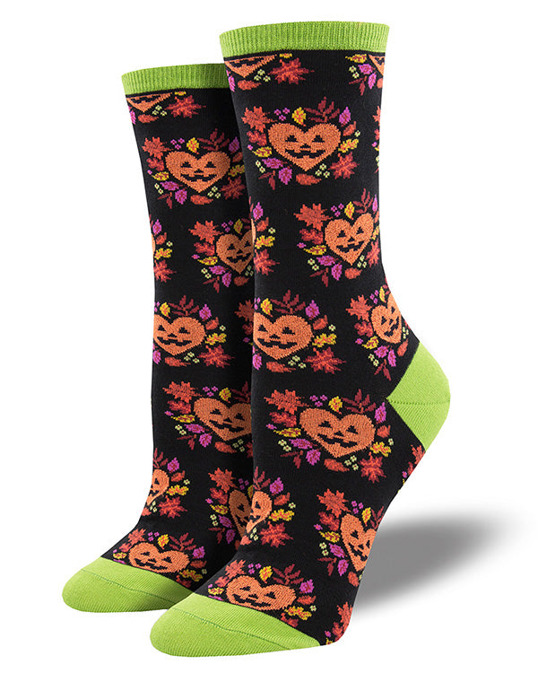 Cute Halloween socks with orange heart jack-o-lanterns and fall leaves