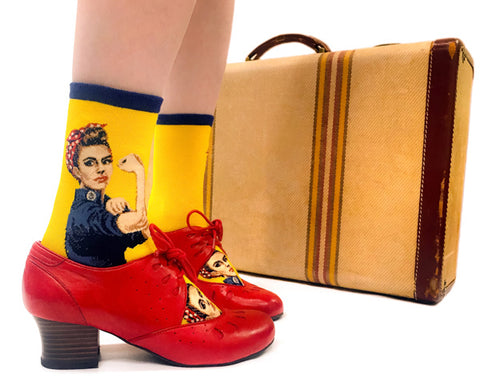 Rosie the Riveter socks with the feminist icon on a yellow background.