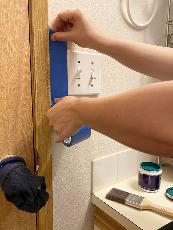 Protect doorknobs from paint drips with old socks