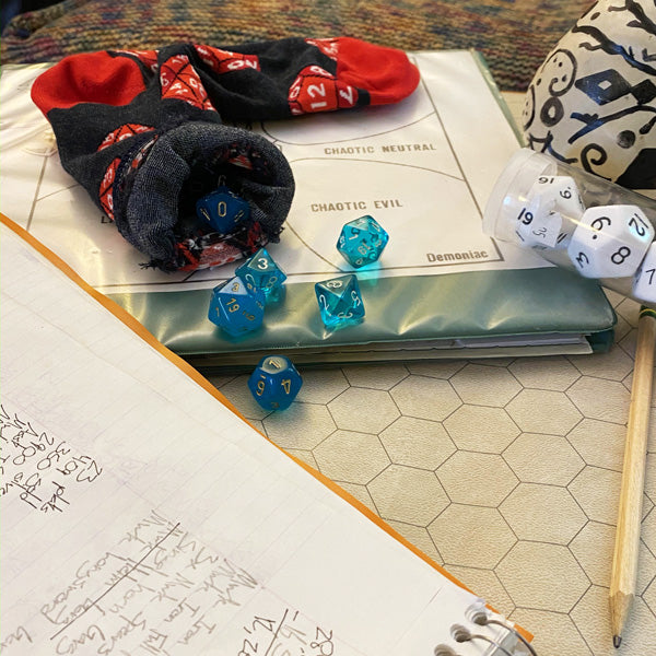 Store dice in a cute bag made out of a single sock